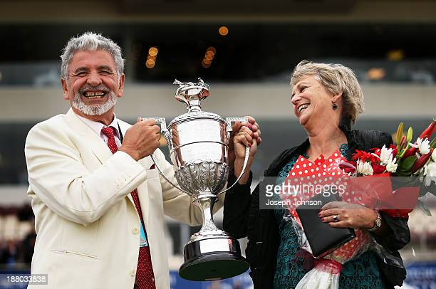 Kypros Kotzikas owner of Master Lavros with the trophy and his partner Jane Campbell after winning the Hellers Dominion Trot during New Zealand...
