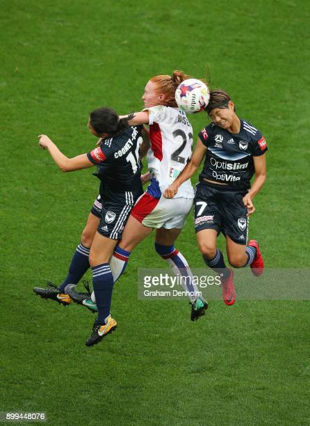 Kyra CooneyCross of the Victory Tori Huster of the Jets and GaEul Jeon of the Victory compete in the air during the round nine WLeague match between...