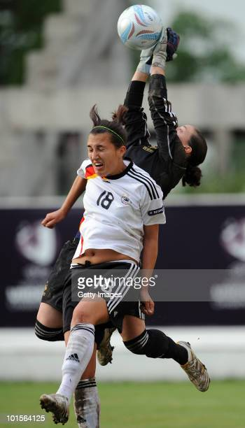 Kyra Malinowskir of Germany fights for the ball with France golkeeper Laetitia Philippe during the UEFA Women's Under19 European Championship...