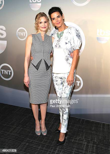 Kyra Sedgwick and Angie Harmon attend the 2014 TNT/TBS Upfront at The Theater at Madison Square Garden on May 14 2014 in New York City