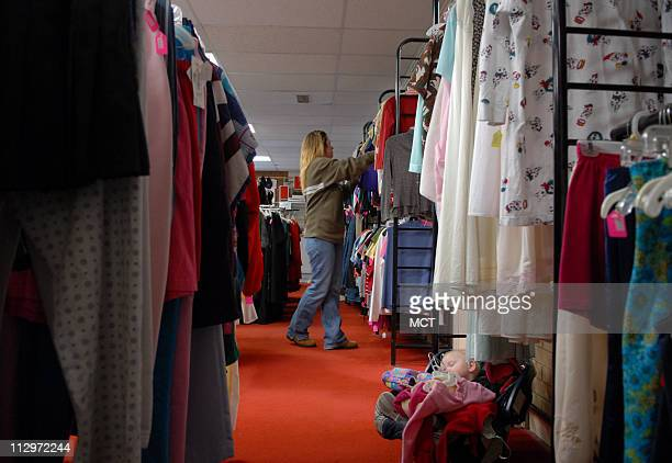 Kyra Wharton shops for clothing for her family of five children including Zoe in car seat at the Douglas/Elbert County Task Force Thrift Store in...