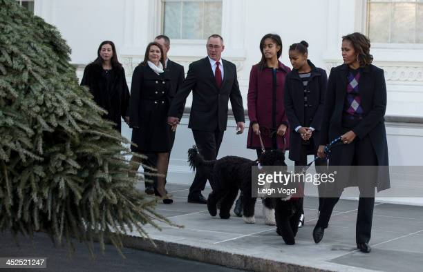 Kyra Yurko Christopher Botek Leslie Wyckoff John Wyckoff Malia Obama Sasha Obama Michelle Obama and dogs Sunny and Bo view the White House Christmas...