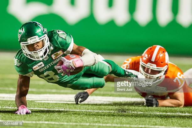 Kyran Moore of the Saskatchewan Roughriders is brought down on a kick return by Edward Godin of the BC Lions in the game between the BC Lions and...