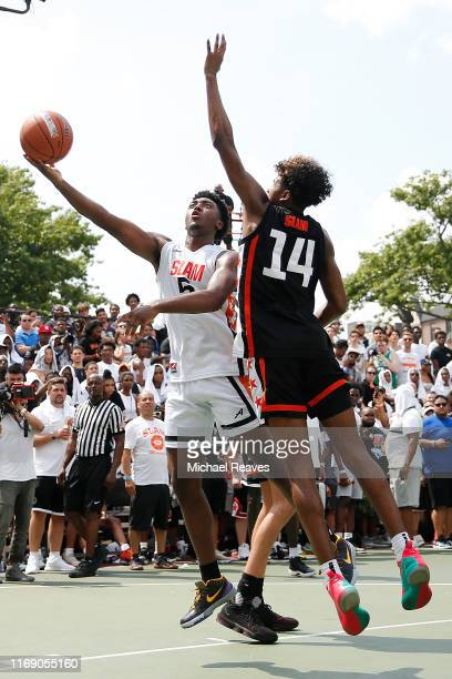 Kyree Walker of Team Jimma goes up for a layup against Jalen Green of Team Zion during the SLAM Summer Classic 2019 at Dyckman Park on August 18 2019...