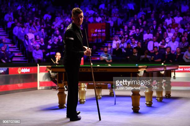 Kyren Wilson of England checks the score during his match against Mark Williams of Walesduring The Dafabet Masters on Day Five at Alexandra Palace on...