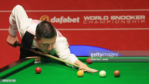 Kyren Wilson of England in actino against Ricky Walden of England during day four of the The Dafabet World Snooker Championship at Crucible Theatre...