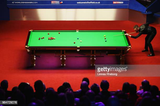 Kyren Wilson of England in action during his match against John Higgins of Scotland during day fourteen of World Snooker Championship at Crucible...