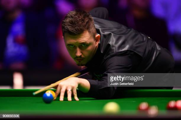 Kyren Wilson of England in action during his match against Mark Williams of Wales during The Dafabet Masters on Day Five at Alexandra Palace on...