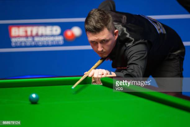 Kyren Wilson of England plays a shot during his first round match against David Grace of England on day one of the World Championship Snooker at the...