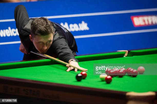 Kyren Wilson of England plays a shot during his second round match against Stuart Bingham of England on day six of Betfred World Championship 2017 at...