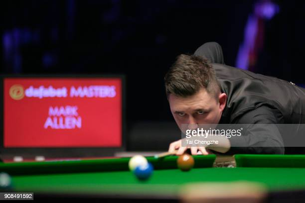 Kyren Wilson of England plays a shot during the final match against Mark Allen of Northern Ireland on day eight of The Dafabet Masters at Alexandra...