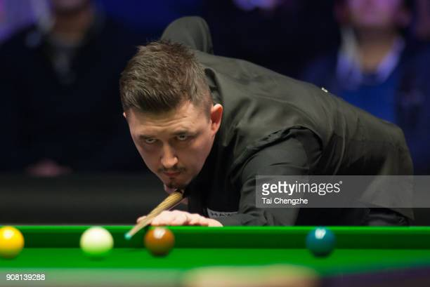 Kyren Wilson of England plays a shot during the semifinal match against Judd Trump of England on day seven of The Dafabet Masters at Alexandra Palace...