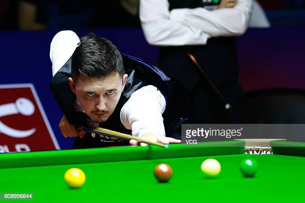Kyren Wilson of England plays a shot in the match against Michael Holt of England on day two of the Shanghai Masters 2016 at Shanghai Grand Stage on...