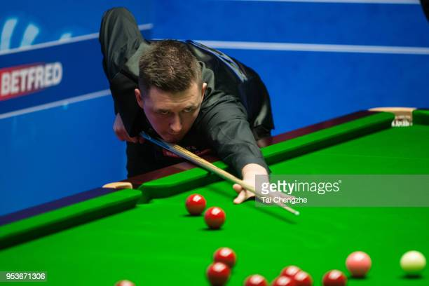 Kyren Wilson of England plays a shot in the quarterfinal match against Mark Allen of Northern Ireland during day eleven of the World Snooker...