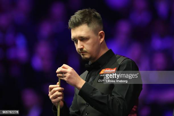 Kyren Wilson of England prepares to play a shot during his first round match against Barry Hawkins of England on day three of The Dafabet Masters at...