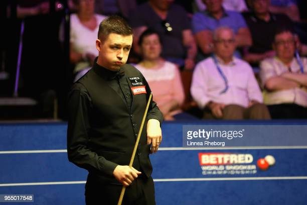 Kyren Wilson of England reacts after a shot in his semifinals match against John Higgins of Scotland during day fifteen of World Snooker Championship...