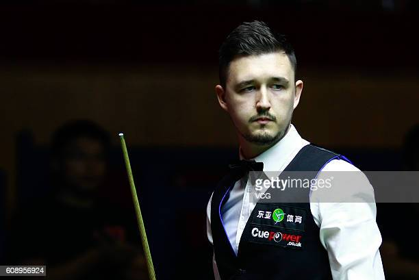 Kyren Wilson of England reacts in the match against Michael Holt of England on day two of the Shanghai Masters 2016 at Shanghai Grand Stage on...