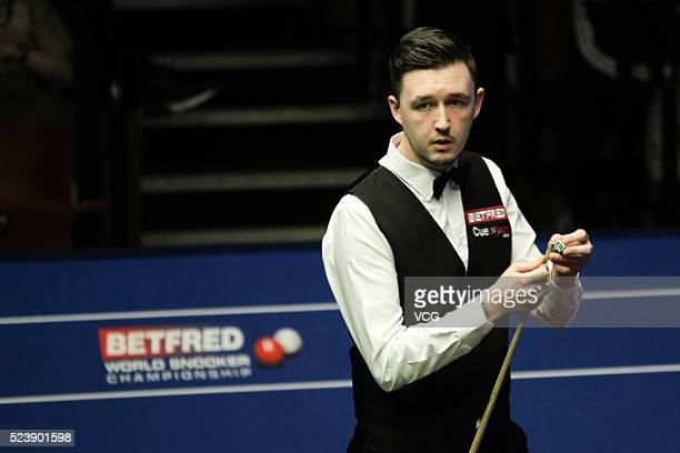 Kyren Wilson of England reacts in the second round match against Mark Allen of Northern Ireland on day nine of Betfred World Championship 2016 at The...