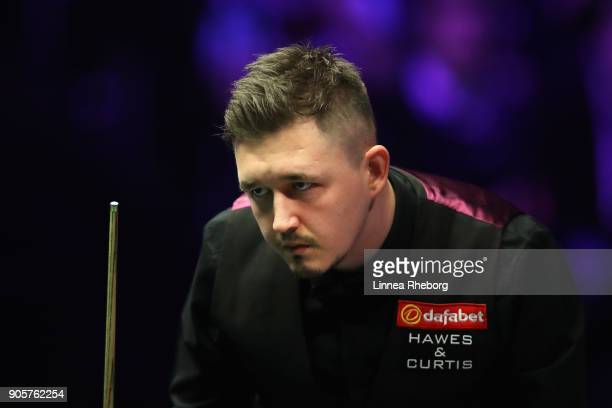 Kyren Wilson of Englandlooks on during his first round match against Barry Hawkins of England on day three of The Dafabet Masters at Alexandra Palace...
