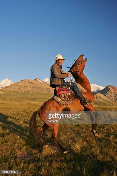 kyrghiz on horseback - キルギス ストックフォトと画像