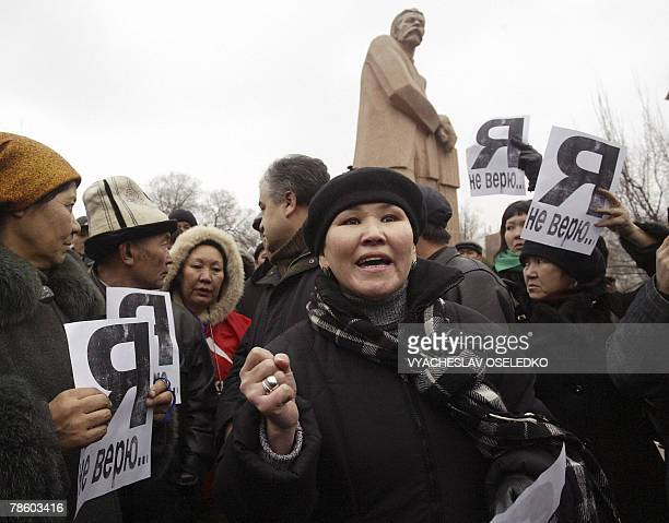 """Kyrgyz Ata-Meken opposition party supporters hold leaflets reading """"I do not believe!"""" during their rally in Bishkek, 21 December 2007. Kyrgyz police..."""