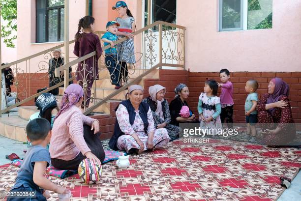 Kyrgyz citizens, who were evacuated from districts bordering Tajikistan following the fighting along the Kyrgyz-Tajik disputed border, are seen...