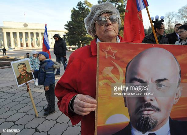 Kyrgyz communist party supporters hold portraits of Vladimir Lenin and Joseph Stalin as they take part in a rally to mark the 99th anniversary of...