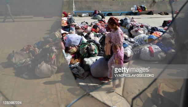 Kyrgyz displaced person receives humanitarian aid in the village of Maksat, near the Kyrgyz-Tajik border, some 1,200 kilometres from Bishkek, on May...