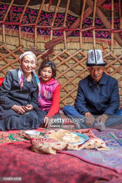kyrgyz family inside a yurt, xinjiang, china - kyrgyzstan stock pictures, royalty-free photos & images