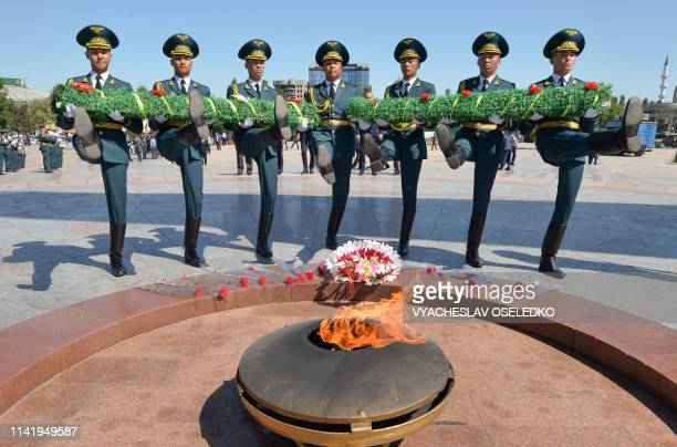 Kyrgyz honour guard soldiers lay a wreath at the Eternal Flame monument during the rally-requiem dedicated to the 74th anniversary of the Allied...