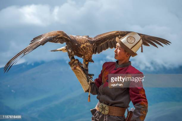 kyrgyz hunter  eagle - kazakhstan stock pictures, royalty-free photos & images