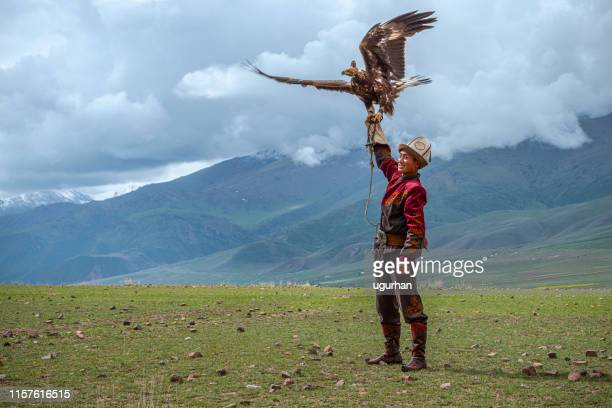 kyrgyz hunter  eagle - kyrgyzstan stock pictures, royalty-free photos & images