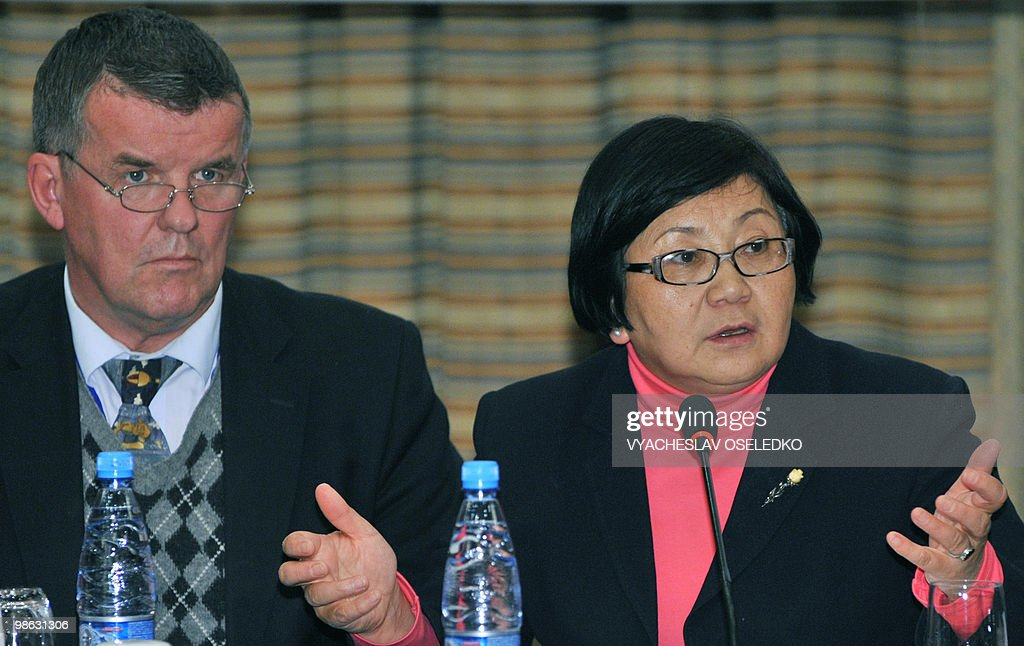 Kyrgyz interim leader Roza Otunbayeva (R) talks during a meeting with the chief of the International Busyness Counsil Hyu Mackinon (L) in Bishkek on April 23, 2010. The ousted president of Kyrgyzstan, who has taken refuge in Belarus, softened his defiance by admitting he would not be able to return to his country as head of state.