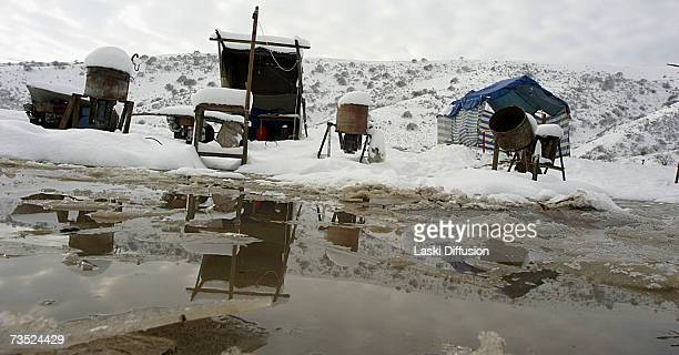 Kyrgyz labourers inhabit primitive camps close to the ruins of an old Soviet elctrolamp factory where they scrape a living scavenging for nickel and...