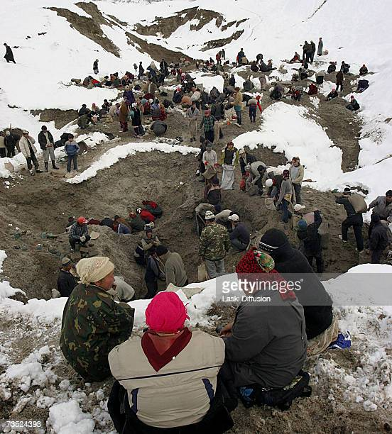 Kyrgyz labourers use hand tools to dig out traces of nickel from the ruins of an old Russian electrolamp plant in this photo taken in January 2007 in...