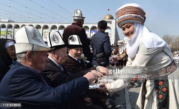 TOPSHOT Kyrgyz men take part in the celebrations of Nowruz at the central AlaToo Square in Bishkek on March 21 2019 Nowruz The New Year in Farsi is...