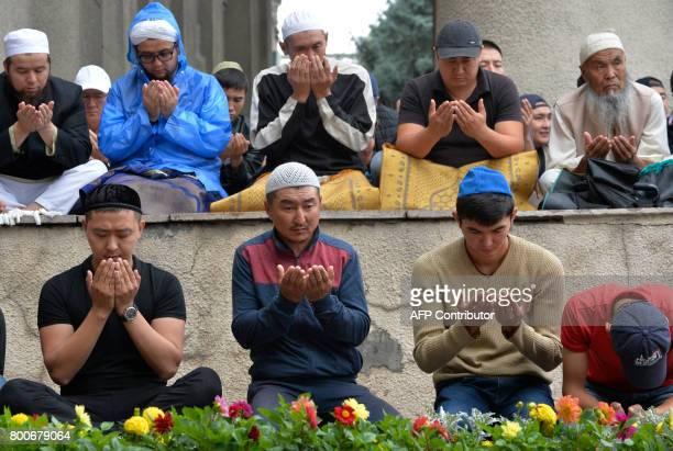 Kyrgyz Muslims pray in central Bishkek on June 25 during celebrations of Eid alFitr marking the end of the Muslim fasting month of Ramadan / AFP...