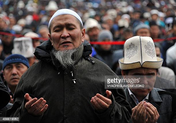 Kyrgyz muslims pray on the first day of the Eid alAdha in Bishkek on October 4 2014 Muslims across the world celebrate the annual festival of Eid...