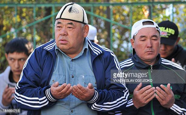 Kyrgyz muslims pray on the first day of the Eid alAdha in the village of KokZhar on the outskirts of Bishkek on October 15 2013 Muslims worldwide...