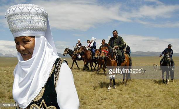 Kyrgyz nomads dressed in traditional garbe approach their temporary settlement on the SonKul plateau 3013 metres above sea level located on the...