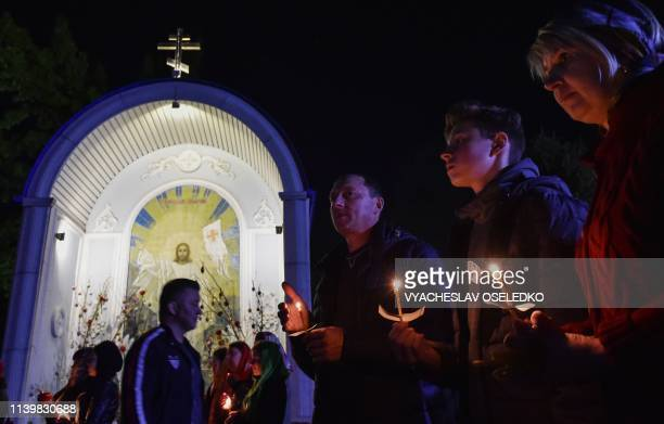Kyrgyz Orthodox believers attend a midnight service as they celebrate Orthodox Easter at a church in Bishkek early on April 28 2019