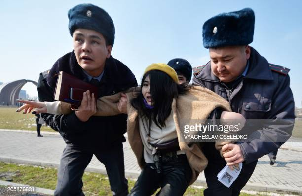 TOPSHOT Kyrgyz police arrest a woman protesting against genderbased violence to mark International Women's Day in Bishkek on March 8 2020 The...