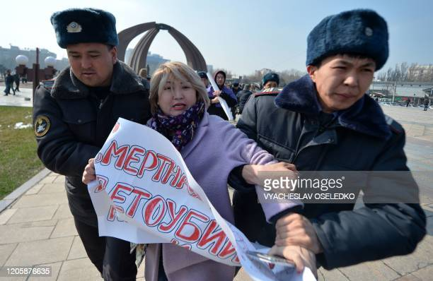 Kyrgyz police arrest a woman protesting against genderbased violence to mark International Women's Day in Bishkek on March 8 2020 The detentions came...