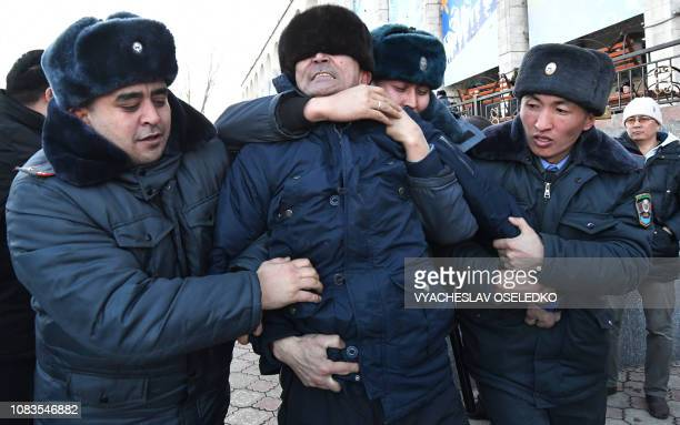 Kyrgyz police officers detain supporters of opposition politician Amanbol Babakulov during a rally against socalled Chinese expansion at the AlaToo...