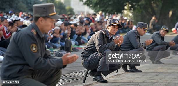 Kyrgyz police officers pray on the first day of the Eid alAdha in Bishkek on September 24 2015 Muslims across the world celebrate the annual festival...