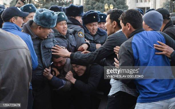 Kyrgyz police scuffle with demonstrators during a rally of supporters of nationalist politician Sadyr Japarov calling for the authorities to release...