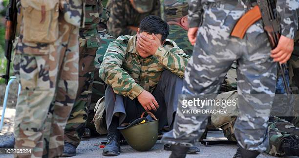 Kyrgyz policeman takes a break, in Osh on June 21, 2010. Security forces in Kyrgyzstan started tracking down those behind the ethnic clashes that...