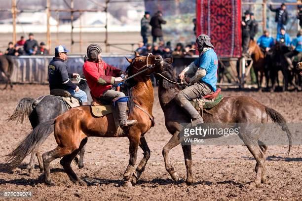 Kyrgyz Republic Travel Images Players of Ulak Tartish in Bishkek Ulak Tartish Kuk Pari Ulak Tyrtysh Kok Boru National game in Kyrgyzstan Two players...