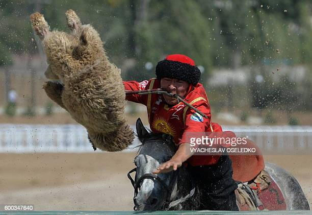Kyrgyz rider plays the traditional Central Asian sport Buzkashi also known as KokBoru or Oglak Tartis during the World Nomad Games 2016 in CholponAta...