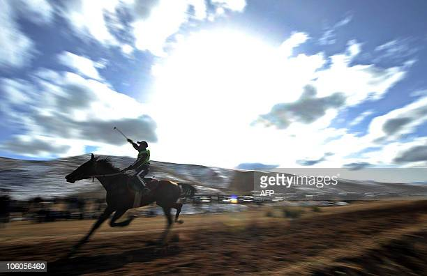 A Kyrgyz rider races during the traditional 'Salburun' hunting festival in the village of Bokonbayevo some 250 kms outside Biskek on October 24 2010...